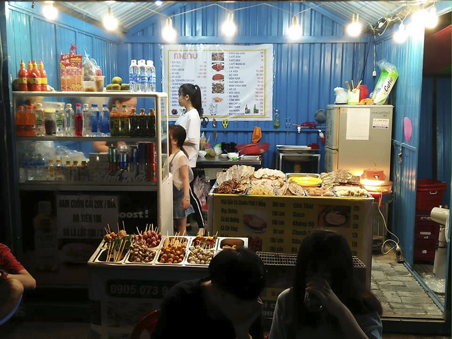shops at night market in da nang